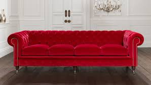 classic modern living room design with red velvet tufted sofa with