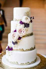 Nothing Says Romance Like A Rustic White Cake Wrapped In Peonies And Lavender