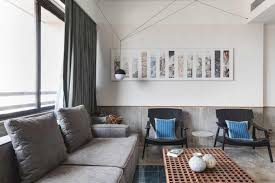 combine concrete tiles and hols a modern living in india