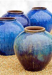 Large Blue Pots In Landscape