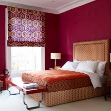 Bedroom With Red Geometric Walls Bed Oversized Headboard In Pattern Footstool And