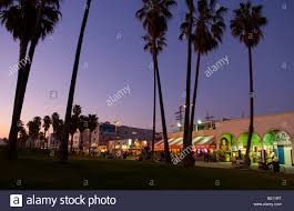 Sunset View With Palm Trees Of Venice Beach California At Night Showing Shops And Nightlife Time Exposure