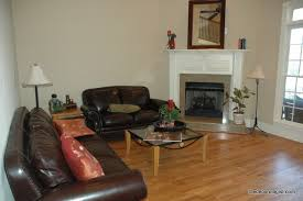 how to arrange furniture in a room with a corner fireplace the