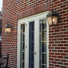 two exterior wall lights provide exterior patio lighting brass