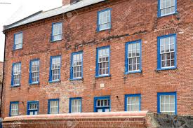 100 Victorian Property With Sash Window Frames Painted Blue Stock Photo