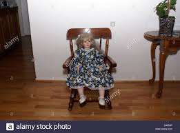Porcelain Doll In Rocking Chair Stock Photo: 54291238 - Alamy