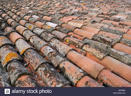mix of and new mission clay roof tiles in umbria italy stock