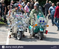 Old Mods Riding On Their Vespa Custom Scooter With Mirrors Lights Logos And Union Jack Decal