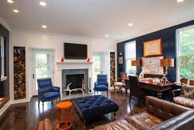 Azure Blue Accent Wall For Elegant Family Room Decorating Ideas With Tufted Ottoman Coffee Table And Stylish Recessed Lighting