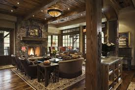 A Rustic Yet Elegant Living Room In Wood And Stone The Burning Fireplace