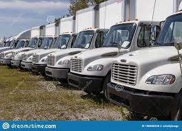 100 Used Freightliner Trucks Semi Tractor Trailer Lined Up For Sale