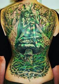 Read Complete Green Gothic Fairy Girl Sitting On Mushroom Tattoo Full Back