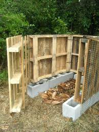 Cinder Block And Wood Fence Compost Bin Made From Pallets With Door Open