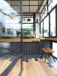 hexagon tiles transition into wood flooring inside this cafe in