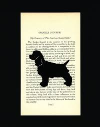 Cocker Spaniel Puppy Hand cut Silhouette Mounted on Vintage Dog Book Page