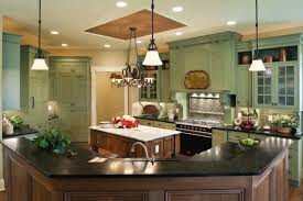 A Country Kitchen In Pale Green With Small Preparation Island Natural Wood And An