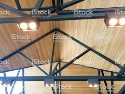 100 Wooden Ceiling And Black Steel Frame With Light Lamp Stock