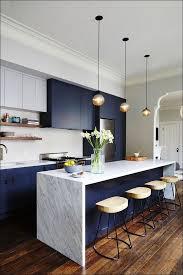 dark grey quartz countertops with white cabinets monsterlune