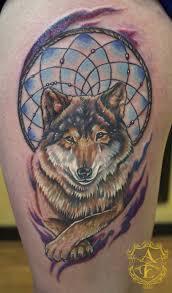 Grey Ink Wolf Dream Catcher Tattoo Design Photo