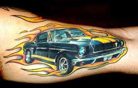 This Car Tattoo Celebrates The 1960s Chevrolet Camaro With Racing Stripes And Flame Designs
