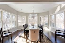 Large Sun Filled Dining Room Surrounded By Windows