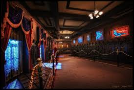 The Haunted Mansion Hallway Take Note Of Stanchions Dark Wood Paneling Changing Portraits And Busts At End Corridor