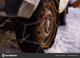 Snow Chains On Vehicle — Stock Photo © Sinenkiy #140246360