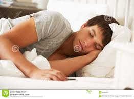 teenage boy asleep in bed at home stock photo image 55895637