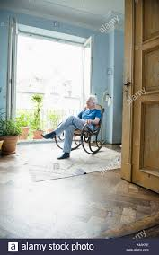 Mature Man Sitting In Rocking Chair Stock Photo: 278059586 ... Rocking Chair For Nturing And The Nursery Gary Weeks Coral Coast Norwood Inoutdoor Horizontal Slat Back Product Review Video Fort Lauderdale Airport Has Rocking Chairs To Sit Watch Young Man Sitting On Chair Using Laptop Stock Photo Tips Choosing A Glider Or Lumat Bago Chairs With Inlay Antesala Round Elderly In By Window Reading D2400_140 Art 115 Journals Sad Senior Woman Glasses Vintage Childs Sugar Barrel Album Imgur Gaia Serena Oat Amazoncom Stool Comfortable Cushion