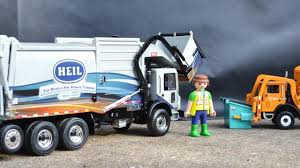 Garbage Truck Videos For Children L Heil Front Loader Garbage Play ... Garbage Truck Videos For Children Toy Bruder And Tonka Diggers Truck Excavator Trash Pack Sewer Playset Vs Angry Birds Minions Play Doh Factory For Kids Youtube Unboxing Garbage Toys Kids Children Number Counting Trucks Count 1 To 10 Simulator 2011 Gameplay Hd Youtube Video Binkie Tv Learn Colors With Funny