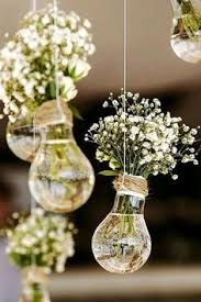 Budget Rustic Wedding Decorations Flowers Gypsophila In Vases Similar To Light Bulbs Suspended On A Rope