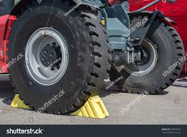 Yellow Wheel Chocks Under Big Black Stock Photo 755978737 ... Goodyear Wheel Chocks Twosided Rubber Discount Ramps Adjustable Motorcycle Chock 17 21 Tires Bike Stand Resin Car And Truck By Blackgray Secure Motorcycle Superior Heavy Duty Black Safety Chocktrailer Checkers Aviation With 18 In Rope For Small Camco Manufacturing Truck Bed Wheel Chock Mount Pair Buy Online Today Titan Wheels Gallery Pinterest Laminated 8 X 712