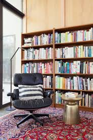 Reading Nook With Chic Eames Lounge Chair | HGTV Eames Lounge Chair Ottoman Armchair Vitra A Colorful And Eclectic Brooklyn Apartment Home Tour Lonny Replica Vintage Brown Walnut Fniture 9 Smallspace Ideas To Steal From A Tiny Paris By Charles Ray 1956 Pnc Real Estate Newsfeed Lovinna Storage Unit Esu Shelf Stock Photos Herman Miller The Century House Madison Wi Ding Portvetonccom