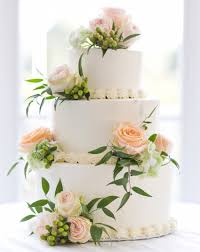 White Wedding Cake With And Peach Roses