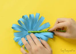 Once You Are Happy With How Full Your Paper Flower Craft Is Looking Apply Some Glue Onto The Green Straw And Press It In Middle Of