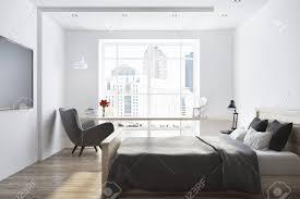 loft weiße wand schlafzimmer mit einem fernseher auf einer dunklen holzwand und einer grauen bettdecke spott der wiedergabe 3d oben