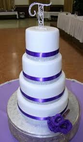 White Round 4 Tier Wedding Cake With Purple And Crystal Bands Monogram Topper