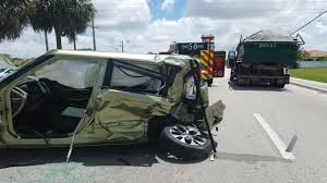Driver Trapped In Kia Soul After Collision With Dump Truck
