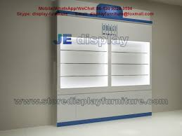 nutrition cosmetics wall cabinet with led light glass shelves and