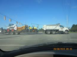 100 Skid Truck A White Ford F650 Dump Truck Hauling A Rollerpaver Skid Steer