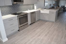 neat kitchen area using oak ceramic tile wood wood look plank