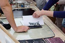 Linocut Printing Using A Design Cut Into Linoleum To Make Print On Paper