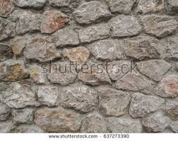 The Wall Of Multi Coloured Stones Agglomerated With Cement Mortar