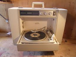 my family had a portable stereo record player very similar to this