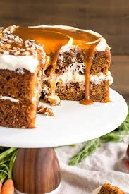 Spiced carrot cake layers infused with maple syrup and topped with maple caramel & cream cheese frosting