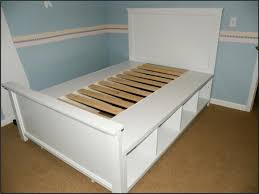 DIY Full Size Storage Bed shelving units on their sides wooden