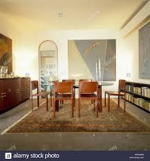 View Of A Dining Room Decorated With Abstract Art