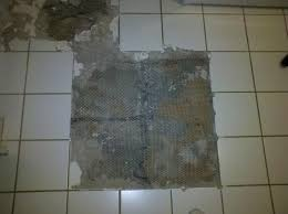 removing ceramic tile maybe set with adhesive doityourself