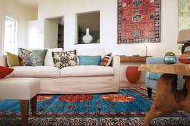 Living Room With White Sofa And Turkish Rug