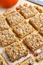 Pumpkin Gingersnap Cheesecake Bars pumpkin cheesecake gingersnap streusel bars on closet cooking
